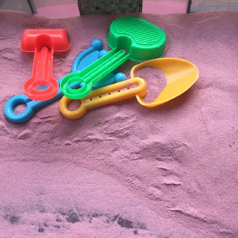 Pink play sand